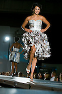 Omaha, NEB 9/19/09.A model struts the catwalk with a dress made out of mostly newspaper designed by Claire Landolt...Chris Machian/The World-Herald