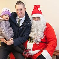 Clare Footballer Enda Coughlan, with is daughter Abbey, visiting Santa at the Kilmurry Ibrickane GAA Centenary Closing Ceremony
