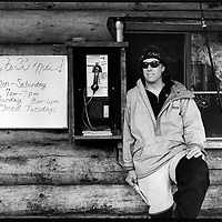 Seandog, Alaska Heli-ski proprietor pictured beside his (then) office phone on the wall of the local diner, Haines, Alaska.