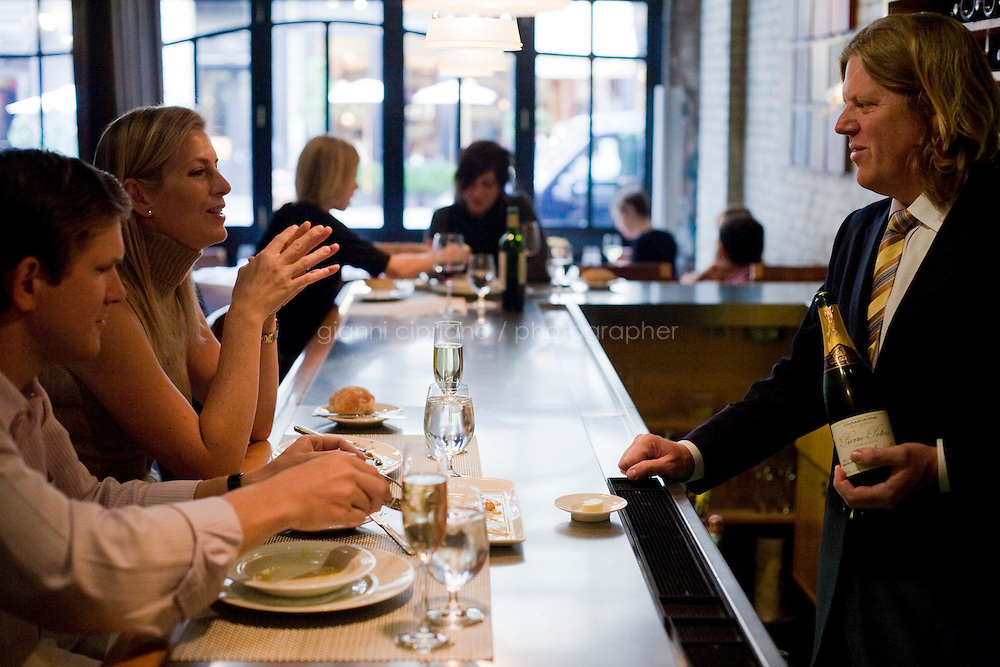 8 October, 2008. New York, NY. Customers have lunch and chat with wine director Tim Kopec at the Veritas Restaurant  in the Flatiron district, NYC.<br /> <br /> ©2008 Gianni Cipriano for The New York Times<br /> cell. +1 646 465 2168 (USA)<br /> cell. +1 328 567 7923 (Italy)<br /> gianni@giannicipriano.com<br /> www.giannicipriano.com