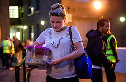© Licensed to London News Pictures. 23/06/2017. London, UK. A woman carries a pet in a container as residents areevacuated from the Taplow block of the Chalcots Estate in Camden after it failed a fire inspection because of combustable cladding. Prime Minister Theresa May has told Parliament that up to 600 high rise tower blocks may have similar cladding to that found in Grenfell Tower, which went on fire last week, in which as many as 79 residents are thought to have perished Photo credit: Ben Cawthra/LNP