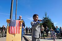 Seven year-old Xavian Balaoro from Salinas sings God Bless America at a memorial ceremony Sunday at the Monterey County Vietnam Veterans Memorial in Salinas.