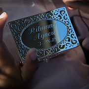 """Rihanna Agnew holds her memory box, March 28, 2018. The family stopped at the mall on the way to the hearing, an adoption day tradition in the Agnew family, to pick out a box and have it engraved with the name and date. Aliyah choose to change her name, to Rihanna, after her favorite singer. She carefully spelled it and then watched as it was engraved on the lid of the box. """"Oh my gosh,"""" Aliyah said, """"it's really happening."""