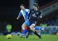 18/12/2004 - FA Barclays Premiership - Blackburn Rovers v Everton - Ewood Park<br />Everton's Kevin Kilbane passes the ball awy from Blackburn Rovers' Barry Ferguson<br />Photo:Jed Leicester/Back Page Images