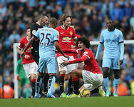 Manchester City's Fernandinho tussles with Manchester United's Marouane Fellaini<br /> <br /> - Barclays Premier League - Manchester City vs Manchester Utd - Etihad Stadium - Manchester - England - 2nd November 2014  - Picture David Klein/Sportimage