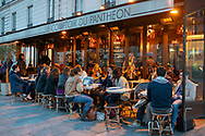 Young adults enjoy an autumn evening at an outdoor sidewalk cafe in Paris, France. (October 30, 2018)