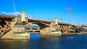 USA, Oregon, Portland, kayakers paddling under the Burnside Bridge.