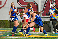 Laconia's #10/Jones and Winnisquam's #7/ Tierney go after the ball during NHIAA Division III Field Hockey Friday afternoon.  (Karen Bobotas/for the Laconia Daily Sun)