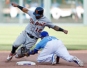 Detroit Tigers' Leonys Martin (12) is tagged out by Kansas City Royals shortstop Alcides Escobar (2) after attempting to steal second base in the ninth inning of a baseball game at Kauffman Stadium in Kansas City, Mo., Saturday, May. 5, 2018. (AP Photo/Colin E. Braley)