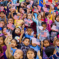 112912       Cable Hoover<br /> <br /> Students at the Baca Community School in Prewitt wave American flags to greet Codetalker Joe Vandever Sr. to their assembly Thursday.
