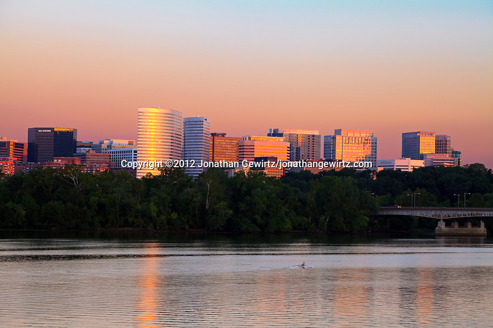 A rower on the Potomac River glides past the shiny office towers of Rosslyn, Virginia shortly after sunrise. WATERMARKS WILL NOT APPEAR ON PRINTS OR LICENSED IMAGES.