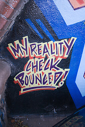 Humorous wall mural with the words 'My reality check bounced',