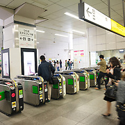 Passengers pass through ticket gates at Akihabara subway station, Tokyo.