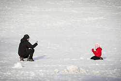 © Licensed to London News Pictures . 26/01/2013 . Salford , UK . People enjoy fresh overnight snow this morning (26th January 2013) in Buile Hill Park , Salford . Photo credit : Joel Goodman/LNP