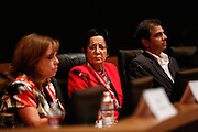 Deepka Lalwani, center, reacts to a response give by Marsha Grilli, foreground, during the Milpitas City Council Forum at Milpitas City Hall in Milpitas, California, on October 9, 2014. (Stan Olszewski/SOSKIphoto)