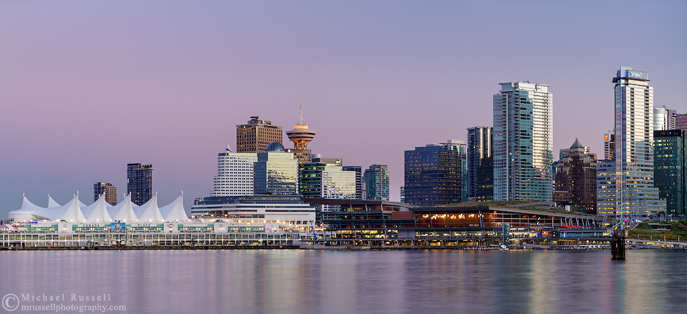 Earth's shadow rises behind downtown Vancouver's Canada Place and the Trade and Convention Center building in Vancouver, British Columbia, Canada