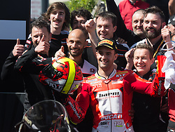February 25, 2018 - Melbourne, Victoria, Australia - Spanish rider Xavi Fores (#12) of Barni Racing celebrates with his team after finishing in third place in the second race on day 3 of the opening round of the 2018 World Superbike season at the Phillip Island circuit in Phillip Island, Australia. (Credit Image: © Theo Karanikos via ZUMA Wire)