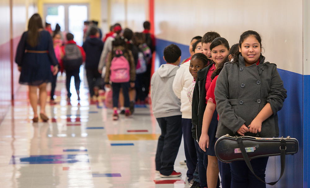 Students line up for class on Monday in the new Sherman Elementary School.