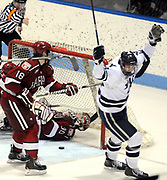 Harvard at Yale, men's hockey, Ingalls Rink.  Yale's 3rd goal, 2nd period, Yale's Antoine Laganiere celebrating, assisted Trent Ruffolo in the goal. Harvard's Mike Seward left and goalie Raphael Girard. Mara Lavitt/New Haven Register<br /> <br /> 1/18/13