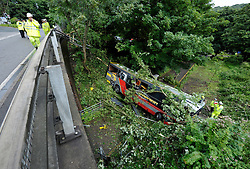© Licensed to London News Pictures. 15/08/2012. Bath, UK. The area where a coach carrying an American band called Baroness crashed off the road and down a slope at Brass Knocker Hill on the A36 near Bath. The band had played in Bristol last night and were en route to Southampton.  They have now announced they have cancelled the last gig of their tour.  15 August 2012..Photo credit: Simon Chapman/LNP
