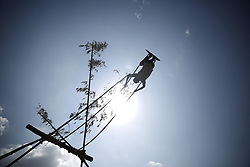 September 23, 2017 - Bhaktapur, Nepal - A Nepalese boy plays on a swing as part of traditions during the Dashain festival in Bhaktapur, Nepal on Saturday, September 23, 2017. (Credit Image: © Skanda Gautam via ZUMA Wire)