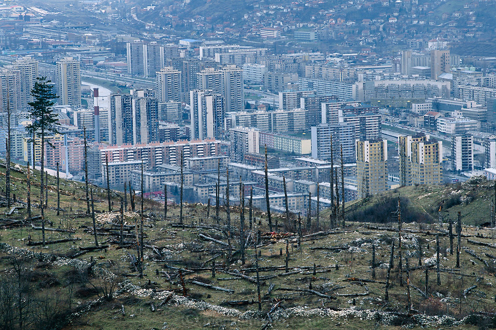 Signs of the four-year siege of Sarajevo (former Serb gun emplacements overlooking the city) are still obvious today. Hungry Planet: What the World Eats (p. 48). This image is featured alongside the Dudo family images in Hungry Planet: What the World Eats.