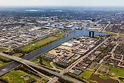 Nederland, Groningen, Gemeente Groningen, 01-05-2013; Oosterhogebrug, met woonschepenhaven, bedrijventerrein en woontoren Tasmantoren, de binnenstad in de achtergrond. Knooppunt van waterwegen: Eemskanaal (onder en links), begin van Van Starkenborghkanaal (re).  Provinciale weg N46.<br /> View on Groningen, residential tower Tasmantoren , Eemskanaal (channel) and business park.<br /> luchtfoto (toeslag op standard tarieven)<br /> aerial photo (additional fee required)<br /> copyright foto/photo Siebe Swart