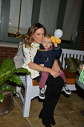 The Ivy Chelsea Garden's Guy Fawkes Party & Launch of The Winter Garden was held on 5th November 2016.<br /> Picture shows:- NATALIE PINKHAM and her son WILF WALBYOFF.