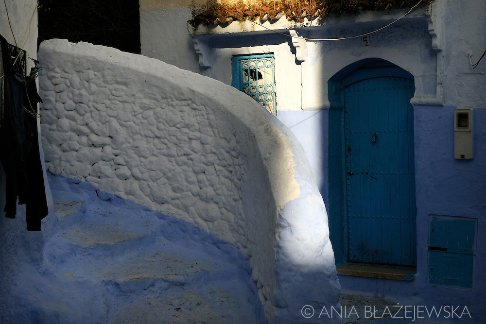 Morocco, Chefchaouen. Light and shadows in the street.