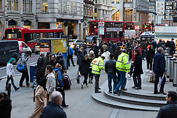 © Licensed to London News Pictures. 22/12/2015. London, UK. The rush hour begins early as people leave work in the City of London near Liverpool Street station. Today is the start of the annual festive Christmas getaway, which combined with last minute shopping and regular commuting is expected to lead to packed trains and congested roads across the country. Photo credit : Vickie Flores/LNP
