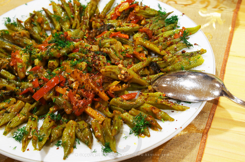 Salad with okra beans, red bell pepper and spices, marinated. Efendi Efendy traditional Turkish and Ottoman Restaurant, The Block, Tirana. Albania, Balkan, Europe.