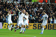 Swansea city's Jonjo Shelvey © celebrates after he scores the 1st goal. Barclays Premier league match, Swansea city v Liverpool at the Liberty Stadium in Swansea, South Wales on Monday 16th Sept 2013. pic by Andrew Orchard, Andrew Orchard sports photography,