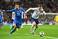 England Forward Jamie Vardy (9) and Italy Midfielder Jorge Luiz Jorginho (14) battle for the ball during the Friendly match between England and Italy at Wembley Stadium, London, England on 27 March 2018. Picture by Stephen Wright.