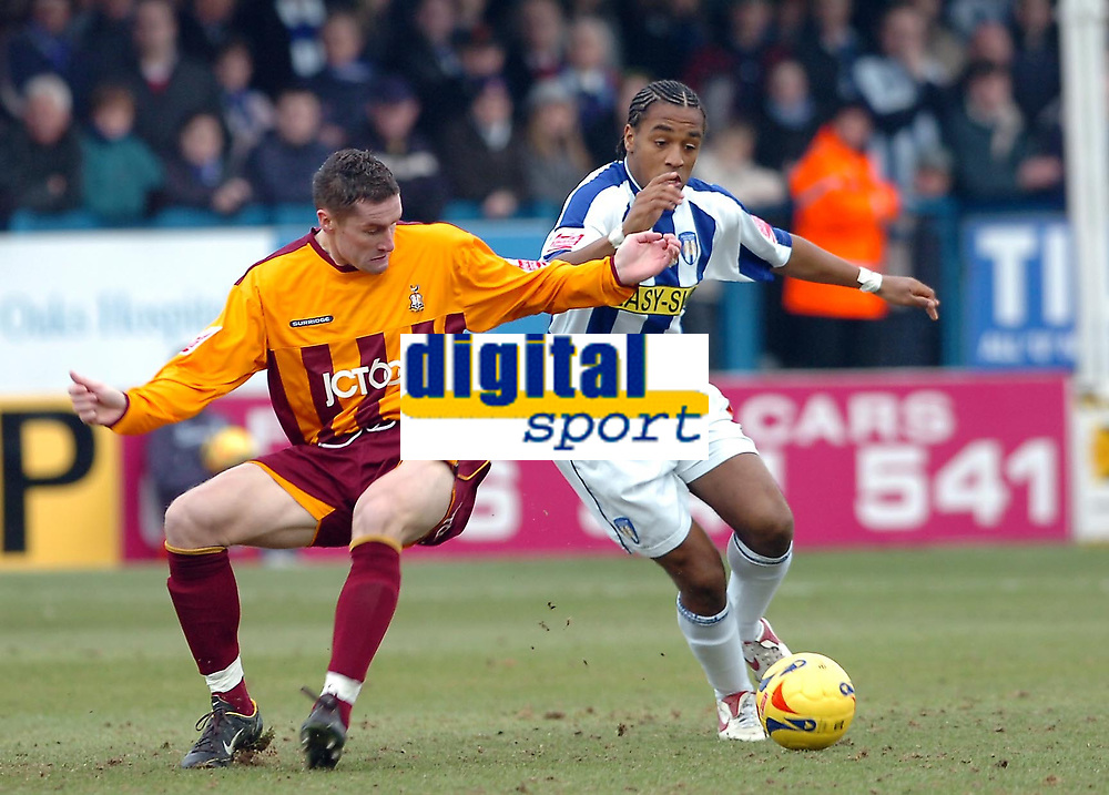 Photo: Kevin Poolman.<br />Colchester United v Bradford City. Coca Cola League 1. 04/02/2006. Bradford's Andy Cooke (L) and Neil Danns fight for the ball.