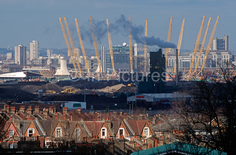 A 1998 construction landscape of Greenwich rooftops and in the distance, The Millennium Dome later to become the 02 Arena on the Greenwich Peninsular, on 25th March 1998, in London, England.