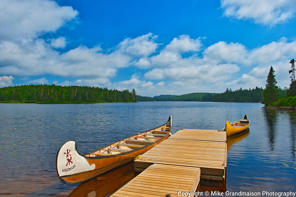 Canoe and dock on Lac du fou<br />La Mauricie National Park<br />Quebec<br />Canada