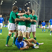 Irish Players congratulate Brian O' Driscoll, Ireland, after scoring a try as Tommaso Benvenuti, Italy, lies on the ground after failing to make the  tackle  during the Ireland V Italy Pool C match during the IRB Rugby World Cup tournament. Otago Stadium, Dunedin, New Zealand, 2nd October 2011. Photo Tim Clayton...