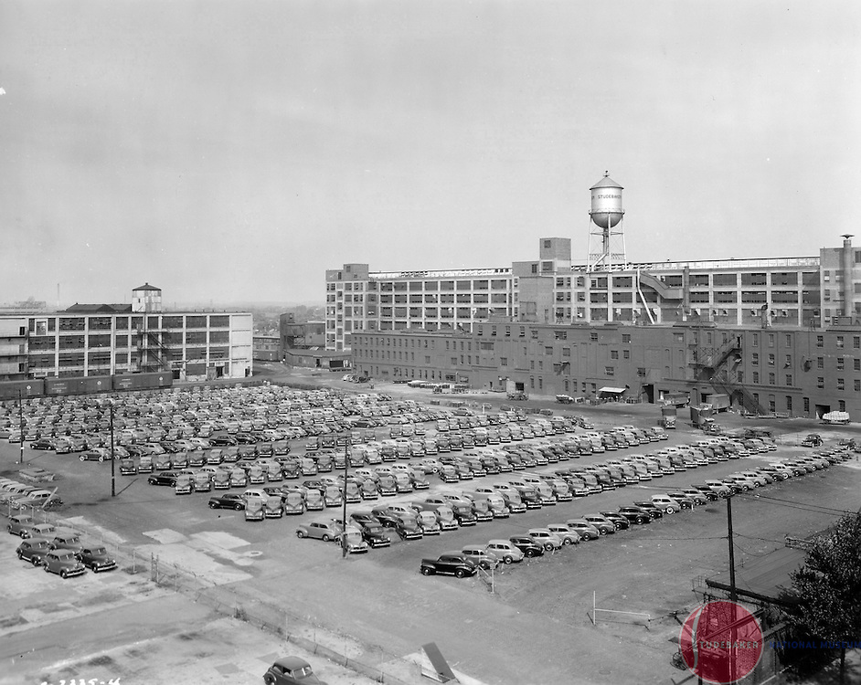 Studebaker's Body Plant (#84, with water tower) and building #69 (left) are shown in this 1941 image.  New 1941 Studebakers are parked awaiting shipment. The older structure in front of the body plant was torn down the mid 1940s. This view faces northwest.