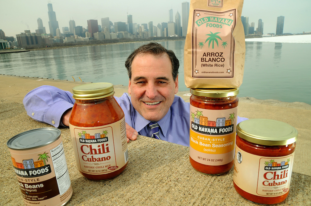 """Monday, March 9, 2009- WGN Television reporter Julian Crews displays his """"Old Havana"""" line of traditional Cuban food products at Chicago's lakefront."""