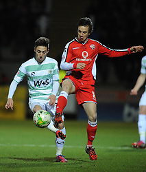 Walsall's James Baxendale is tackled by Yeovil Town's Josh Sheenan  - Photo mandatory by-line: Harry Trump/JMP - Mobile: 07966 386802 - 03/03/15 - SPORT - Football - Sky Bet League One - Yeovil v Walsall - Huish Park, Yeovil, England.