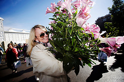 ***LNP HIGHLIGHTS OF THE WEEK 30/05/14***<br /> <br /> © Licensed to London News Pictures. 24/05/2014. London, UK. a woman leaving the show carrying her purchases. On the last day of the RHS Chelsea Flower Show, plants are traditionally sold off to visitors from 4pm until the show closes. Visitors are able to purchase the flowers in advance on the day but pick-up commences at 4pm. Photo credit: Matthew lloyd/LNP