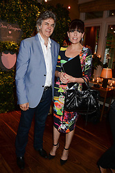DAVID WEBSTER and CLARE DENHAM-SMITH at the Dom Perignon Rose 2002 Dark Jewel launch with Stephen Webster held at The Connaught Hotel, London on 12th June 2013.