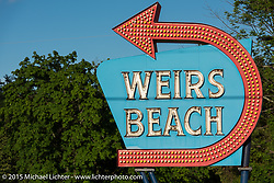 The iconic Weirs Beach sign during Laconia Motorcycle Week. Laconia, NH, USA. June 16, 2015.  Photography ©2015 Michael Lichter.