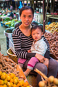 10 MARCH 2013 - VANG VIENG, LAOS: A woman and her child in the market in Vang Vieng, Laos.     PHOTO BY JACK KURTZ