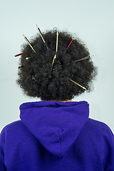 Afro hair with pencils