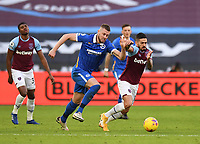 Football - 2020 / 2021 Premier League - West Ham United vs Brighton & Hove Albion - London Stadium<br /> <br /> West Ham United's Manuel Lanzini holds off the challenge from Brighton & Hove Albion's Adam Webster.<br /> <br /> COLORSPORT/ASHLEY WESTERN