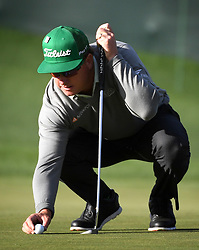 Charley Hoffman places his ball for a putt on the 17th hole during first-round action of the Masters Tournament at Augusta National Golf Club on Thursday, April 6, 2017, in Augusta, Ga. Hoffman finished the round at -7. (Photo by Jeff Siner/Charlotte Observer/TNS) *** Please Use Credit from Credit Field ***