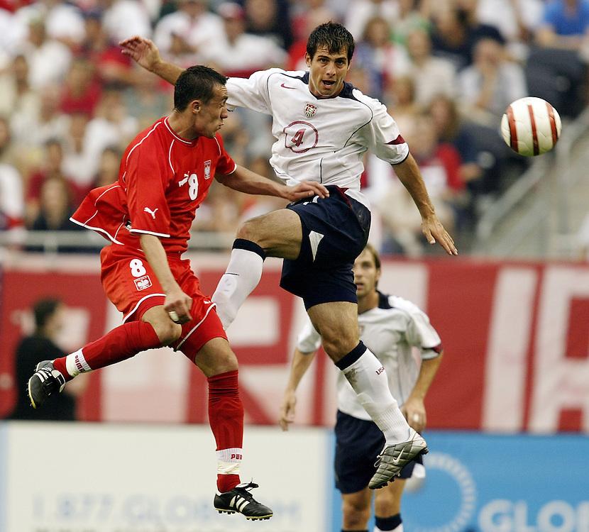 Soccer, USA vs Poland at Soldier Field...USA's Carlos Bocanegra, right,  with Poland's Ireneusz Jelen