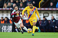 Jason Puncheon of Crystal Palace (r) is  chased by Steven Defour of Burnley. Premier League match, Burnley v Crystal Palace at Turf Moor in Burnley , Lancs on Saturday 5th November 2016.<br /> pic by Chris Stading, Andrew Orchard sports photography.