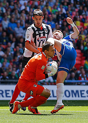 Matt Taylor of Bristol Rovers collides with Goalkeeper James McKeown and Shaun Pearson of Grimsby Town - Photo mandatory by-line: Rogan Thomson/JMP - 07966 386802 - 17/05/2015 - SPORT - FOOTBALL - London, England - Wembley Stadium - Bristol Rovers v Frimsby Town - Vanarama Conference Premier Play-off Final.